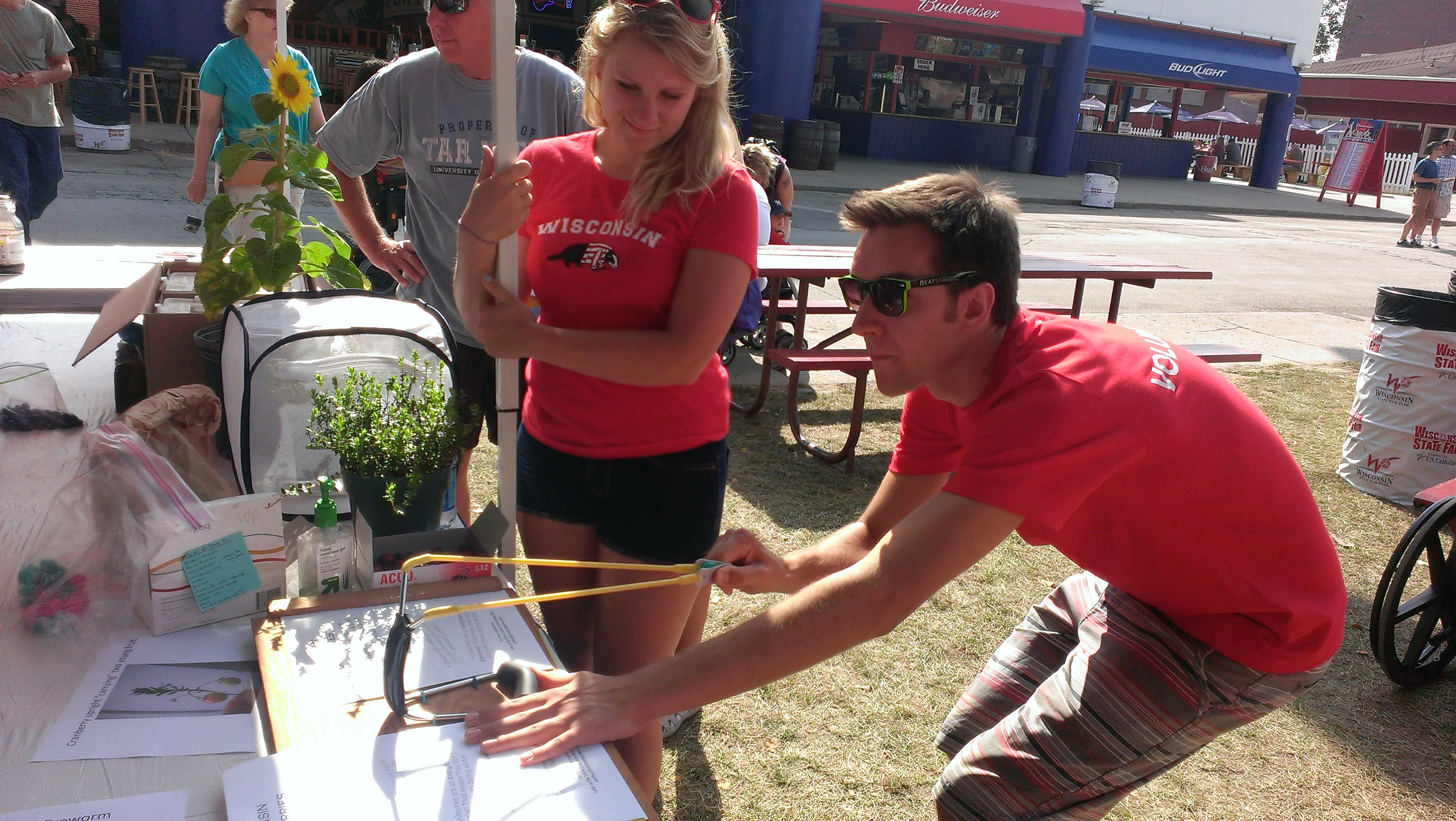 Interactive learning at the Fair: shooting cranberries at key pests